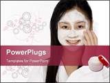 PowerPoint Template - A young Asian woman in a bath robe with a face pack on.