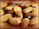 PowerPoint Template - Delicious almonds with peel still on in a pile on wooden surface