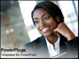 PowerPoint Template - African-American business woman smiles into the distance.