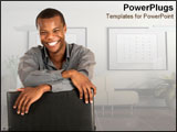 PowerPoint Template - African business man sitting in well-furnished corporate room.