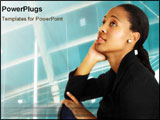 PowerPoint Template - An African business woman sits thoughtfully.