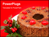 PowerPoint Template - loseup view of a moist delicious holiday fruitcake garnished with holly and photographed against a