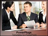 PowerPoint Template - A team of workers sits together and discuss material.