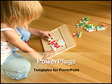 PowerPoint Template - 2-3 years old girl kneeling on the floor and solving jigsaw puzzle