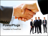 PowerPoint Template - Businessmen shaking hands keyboard and pen and paper in the background
