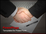 PowerPoint Template - Business handshake over computer keyboard paper and pen