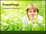 PowerPoint Template - Happy summer. A smiling young boy lying in green grass
