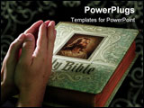 PowerPoint Template - Praying hands over a large closed Bible with Jesus Christ on Cover
