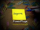 PowerPoint Template - and of person writing the word inspire on a yellow sticky note pad with bulletin board and colorful