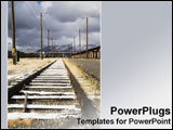 PowerPoint Template - Railroad tracks disappear in the distance.
