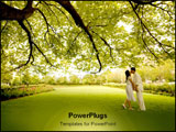 PowerPoint Template - A couple embracing under a big beautiful tree during spring.