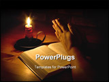 PowerPoint Template - raying next to the bible by candle light. Only light in this image is from the candle. Perfect for