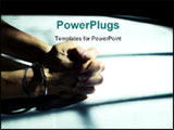 PowerPoint Template - male cuffed hands over dirty white table lit through the cell bars with harsh light