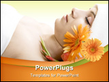 Young beautiful woman is relaxing in spa - wellness with a flower
