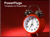 PowerPoint Template - n old fashioned red alarm clock with a white clock face & chrome bells on top on a red side lit bac