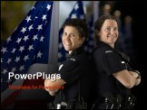 PowerPoint Template - Portrait of two mid adult Caucasian policewomen standing back to back looking over their shoulders s