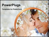 PowerPoint Template - A newly-wed couple kiss in a spring setting.